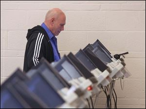 Richard Stiff, of Sylvania, casts his vote at the United Church of Christ polling location in Sylvania.