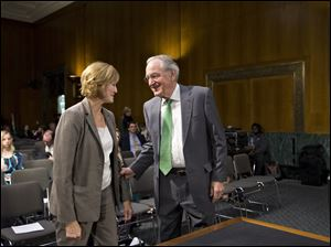 Senate Health, Education, Labor, and Pensions Committee Chairman Sen. Tom Harkin, D-Iowa, greets Medicare chief Marilyn Tavenner at hearing.