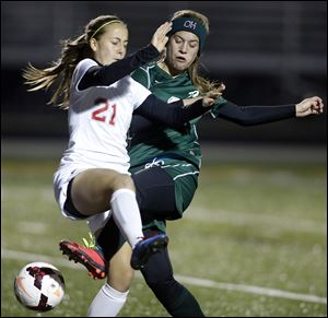Oak Harbor's Alexa Weis, right, collides with  Gates Mills Hawken's Katarina Doncevic during a D-III state girls soccer semifinal match in Sandusky. Oak Harbor's season ends with a record of 19-2-1.