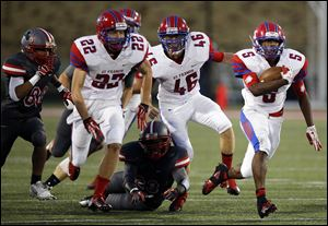 St. Francis de Sales running back Lamar Carswell  runs the ball against Central Cath