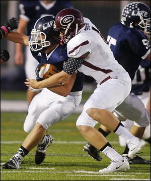 Quentin Spiess makes a tackle against Lake. The senior is Genoa's top receiver with 21 catches for 627 yards.