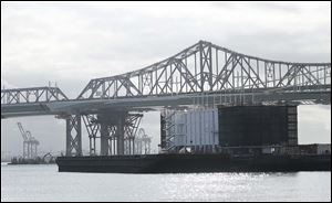 A barge belonging to Google sits near the eastern span of the San Francisco-Oakland Bay Bridge. The barge is one of two mysterious floating structures connected to the tech giant that have sparked online speculation.