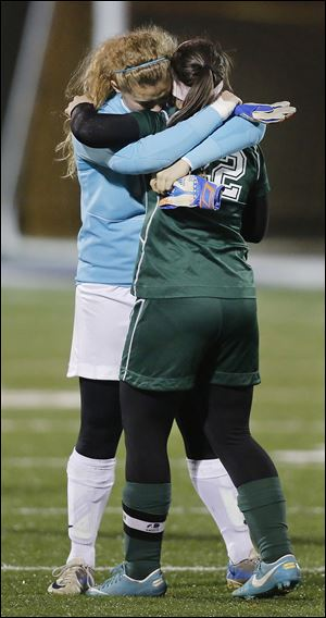 Oak Harbor goalie Ivy Martin, left, and Hannah Hess react to their loss against Gates Mills Hawken. The Hawks defeated Oak Harbor 4-1.