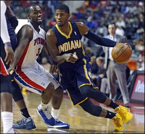 Detroit Pistons guard Rodney Stuckey (3) tries to stay with Indiana Pacers forward Paul George, right, during the first half.