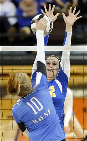 St. Ursula's Lauren Daudelin defends against  Anthony Wayne's McKenzie Gunner in a district semifinal.