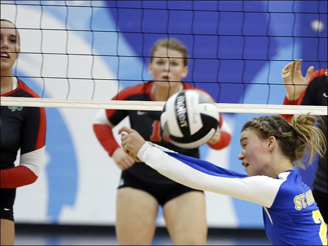 07S5McCabe-4 St. Ursula's Madelyn McCabe hits the ball against Central Catholic. The No. 1-ranked Arrows are 28-0.