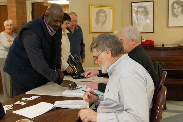 Mayor-Mike-Bell-left-signs-in-before-voting