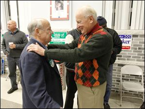 Former Mayor Carty Finkbeiner, right, speaks to Democratic Party Executive Committee member Mike Friedman, left, during the D. Michael Collins election viewing party at the Teamster's Local 20 Hall.