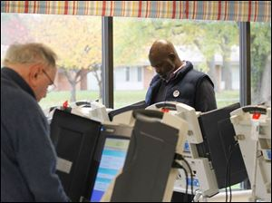 Mayor Mike Bell voting at Pelham Manor polling station.