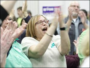 Supporter Jan Harmon applauds D. Michael Collins during his acceptance speech.