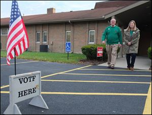 Toledo mayoral candidate D. Michael Collins and his wife, Sandra Drabik, his wife, leave the polling place.