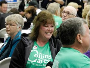 Volunteer Tina Scott reacts to the results during the D. Michael Collins election viewing party.