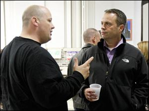 Lucas County Sheriff's Office, Patrick Mangold, left, and The Toledo Police Patrolman's Association Union President Dan Wagner, right, talk.