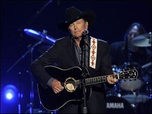 George Strait performing at the 48th Annual Academy of Country Music Awards at the MGM Grand Garden Arena in Las Vegas.