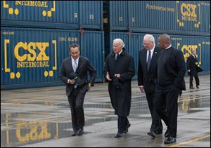 From left: Mr. Oscar Munoz, Chief Operating Officer and Executive Vice President of CSX Corporation, Vice President Joe Biden, Wilby Whitt, CSX Intermodal Terminals Inc. president, and Secretary of Transportation Anthony Foxx, tour CSX.