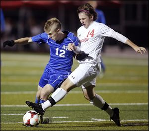 Anthony Wayne's Colin Mortemore, left, battles   Mentor's Nathan Carey in a Division I state boys soccer semifinal at Sandusky Perkins High School. The Generals finish the season 17-1-4.