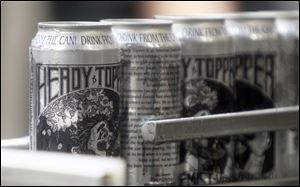 Heady Topper cans roll off the line at the Alchemist brewery in Waterbury, Vt. Sales have grown 600 percent for the company.