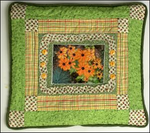 Black-eyed susans on a pillow by quilter Judy Paschalis is among 28 art quilts on display at Downtown Latte in November. A public reception is set for 11 a.m to 1 p.m. Saturday.