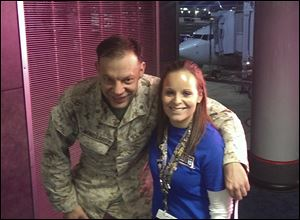 Lindsy Wadas, director of the USO Center at Chicago's O'Hare International Airport with U.S. Marine Maj. Matthew Winkelbauer, left, after he and 13 other Marines arrived.