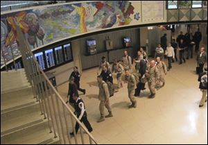 A group of Marines walk through a terminal at Chicago's O'Hare International Airport  during part of their journey back home after a tour of duty in Afghanistan.