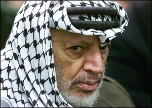 2002 file photo of Palestinian leader Yasser Arafat.
