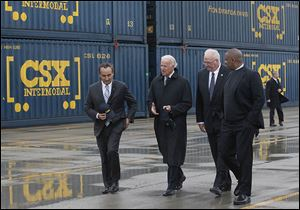 Touring CSX facilities in North Baltimore, Ohio, are, from left, Oscar Munoz, chief operating officer and executive vice president of CSX Corp.; U.S. Vice President Joe Biden; Wilby Whitt, CSX Intermodal Terminals Inc. president; and U.S. Secretary of Transportation Anthony Foxx.