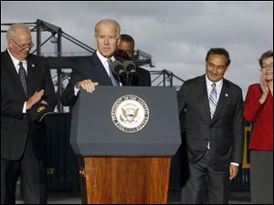 Mr. Biden speaks to the crowd while touring CSX in North Baltimore. Behind from left:  Wilby Whitt, CSX Intermodal Terminals Inc. president,  Secretary of Transportation Anthony Foxx, Mr. Oscar Munoz, Chief Operating Officer and Executive Vice President of CSX Corporation, and  Representative Marcy Kaptur (D - OH).