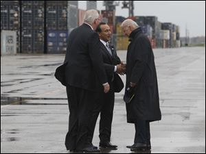 Vice President Joe Biden, right, is pictured with Mr. Munoz and Mr. Whitt.