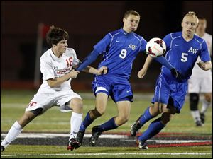 Anthony Wayne's JJ Fortner (9) and Andrew Yokum (5) move the ball against  Mentor's Kurt Raney (16).