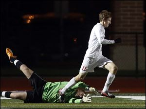 Mentor's Jake Lombardo (11) beats Anthony Wayne goalie Austin Kaminski (24) to score the lone goal of the game.