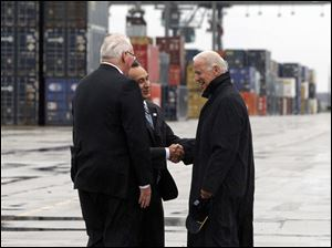 Vice President Joe Biden, right, is greeted by Mr. Oscar Munoz, Chief Operating Officer and Executive Vice President of CSX Corporation, center, and Wilby Whitt,  CSX Intermodal Terminals Inc. president, right.