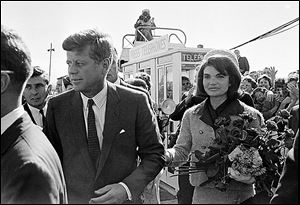 President John F. Kennedy and his wife, Jacqueline Kennedy, arrive at Love Field airport in Dallas on Nov. 22, 1963.