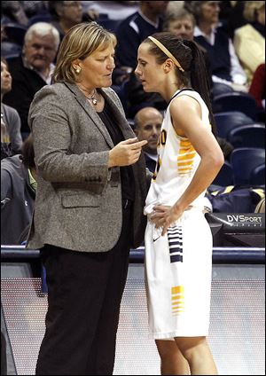 At left, UT coach Tricia Cullop talks with Stephanie Recker during an exhibition game last week at Savage Arena. At right, UT athletic director Mike O'Brien listens as Cullop speaks at her introduction on April 18, 2008. She owns a 125-44 record with the Rockets.