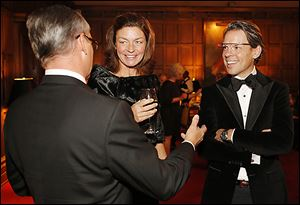 Ted Souder, right, of Google talks with his wife, Lori, and J.B. Rorick during the President's Dinner at the Toledo Club.