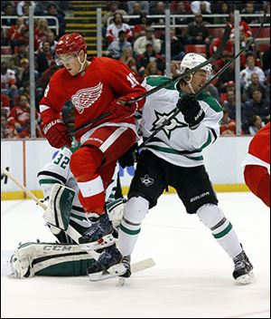 Detroit's Joakim Andersson, left, fights for position with the Stars' Brenden Dillon.