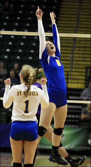 St. Ursula's Lauran Graves, 8, leaps for joy after hitting the match winner during a Div. I state semi-final volleyball game today at the Nutter Center in Fairborn, Ohio.