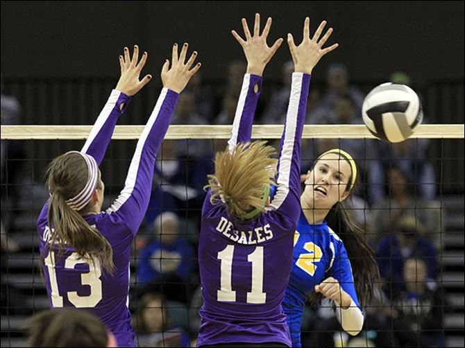 s6spike St. Ursula's Lauren Daudelin, right, hits the ball past Columbus DeSales players Kendall Witt, left, and Emily Durbin. Daudelin finished with 10 kills.