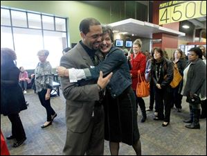 Dr. Romulus L. Durant, left, gets a hug from TPS school nurse Katie Dollman-Schulz, right, during TPS Staff Appreciation Day at Cedar Creek Church.