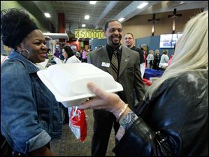 Daphne Jones, left, and Patricia Beumel, right, from Reynolds Elementary, speak with Dr. Romulus L. Durant, center, during TPS Staff Appreciation Day at Cedar Creek Church.