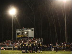 Whiteford's stands were full as the team met on the field before halftime.
