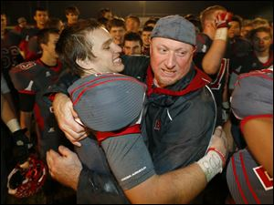 Bedford High School quarterback Brad Boss, left, and head coach Jeff Wood celebrate their win.