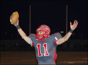 Bedford High School player Alec Hullibarger (11) scores a touchdown in the fourth quarter.