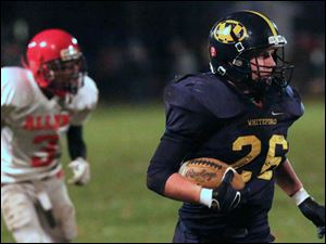 Whiteford's sophomore Cody Keifer (26) evades defenders on his way to the end zone during the second quarter.