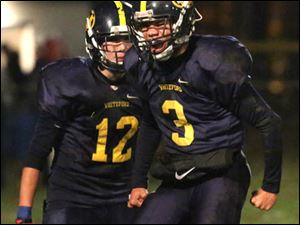 Whiteford9p Whiteford's junior John Reditt (3) cheers with senior Zachary Perry (12) after breaking up a pass during the second quarter.