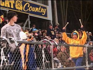 Whiteford's freshman band member Abby Clawson, 13, leads the crowd in a cheer during the third quarter.