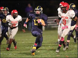 Whiteford's senior Zachary Perry (12) breaks away from the defenders during the first quarter.