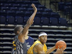 Toledo's J.D. Weatherspoon, right, has played his way into a starting forward position for the Rockets this se