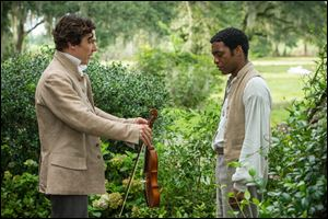 "This image released by Fox Searchlight shows Benedict Cumberbatch, left, and Chiwetel Ejiofor in a scene from ""12 Years A Slave."""