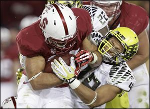 Stanford running back Tyler Gaffney, left, attempts to run past Oregon linebacker Rodney Hardrick during the second quarter Thursday night in Stanford, Calif. Gaffney ran 45 times for 157 yards in the Cardinal's win.