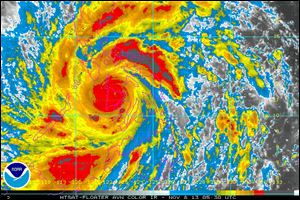In this image provided by NOAA today which was taken at 12:30 a.m. EST shows Typhoon Haiyan as it crosses the Philippines.